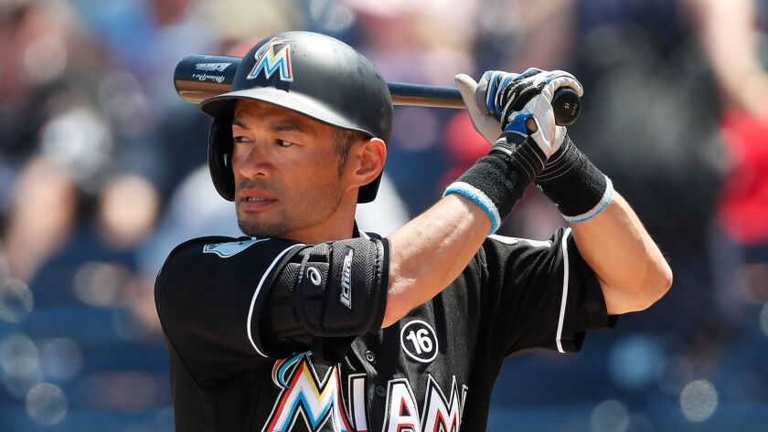 Miami Marlins' Ichiro Suzuki bats against the Houston Astros in the first inning of a spring trainin