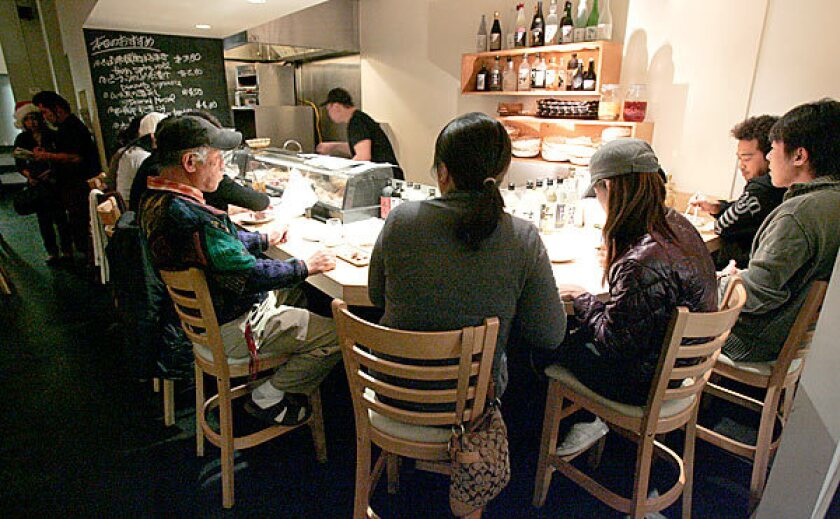At kushiage restaurant Horon in Torrance, bar seating gives customers a view of the cook.