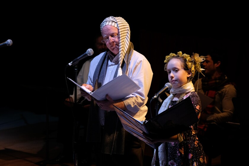 "Edward Howell as Scrooge (left) and Catalina Zelles as the Ghost of Christmas Past in Oceanside Theatre's ""A Christmas Carol: A Radio Play."""