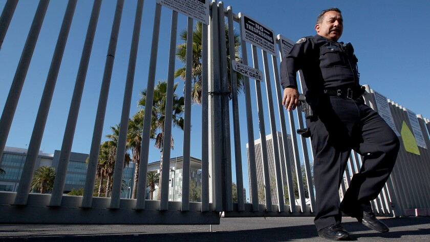 A police officer secures the Robert F. Kennedy Learning Center in Los Angeles after emailed threats jeopardizing the safety of school children forced the closure of all LAUSD schools on Dec. 15, 2015.