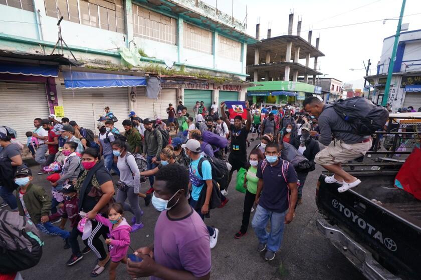 A caravan of migrants head north toward the U.S.-Mexico border from Tapachula, Mexico.