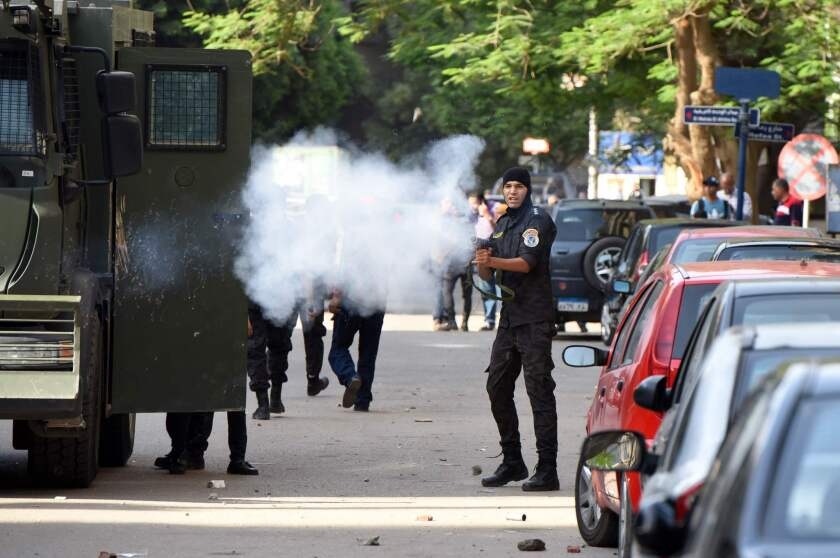 Egyptian riot police fire tear gas toward would-be protesters Monday.