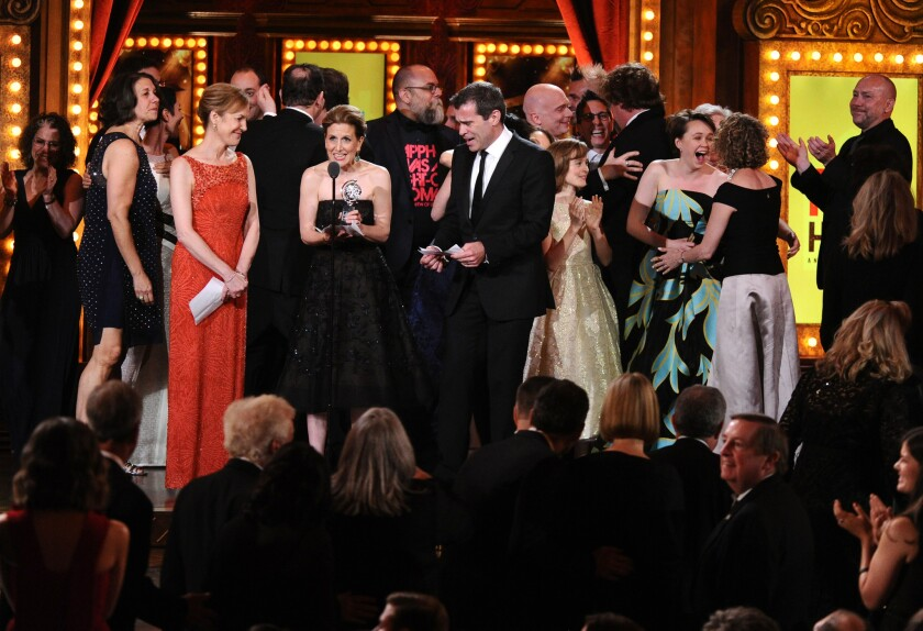 "Kristin Caskey, center, along with cast and crew accepts the award for best musical for ""Fun Home"" during the 69th annual Tony Awards at New York's Radio City Music Hall on June 7, 2015."