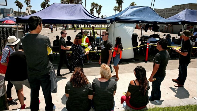 SAG-AFTRA members passed out literature and informed the cast, basketball players and beachgoers abo