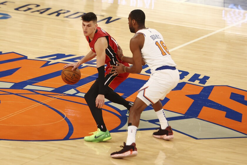 Alec Burks, right, of the New York Knicks defends against Tyler Herro, left, of the Miami Heat during an NBA basketball game on Sunday, Feb. 7, 2021, in New York City. (Mike Stobe/Pool Photo via AP)