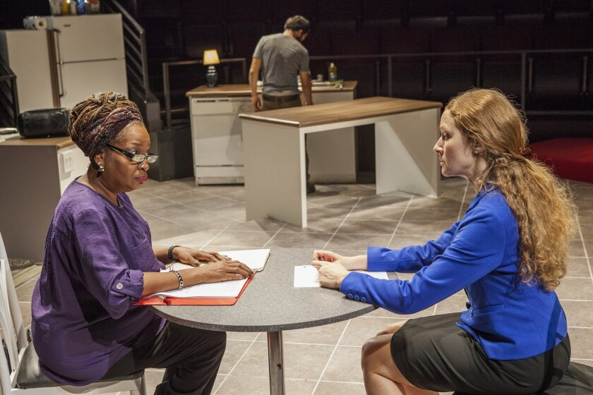 """Sylvia M'Lafi Thompson as Toni and Crystal Ferrin as Jennifer with Carlo Albán (background) in Laura Marks' """"Bethany"""" at The Old Globe."""