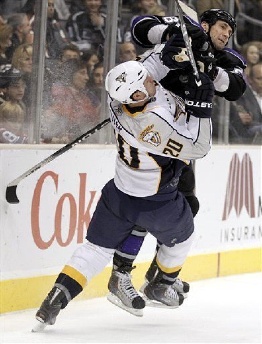 Los Angeles Kings center Jarret Stoll, top, checks Nashville Predators defenseman Ryan Suter during the second period of an NHL hockey game in Los Angeles, Thursday, Jan. 6, 2011. (AP Photo/Chris Carlson)