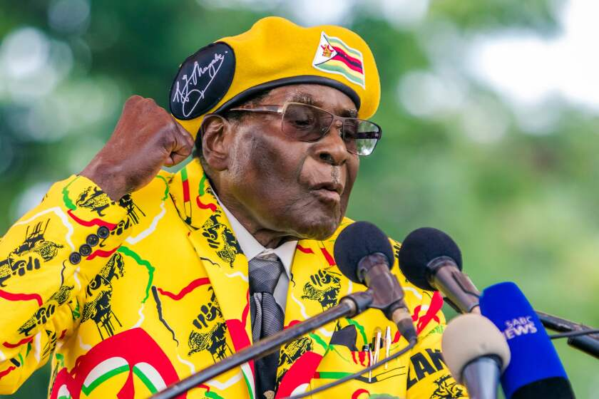 Then-President Robert Mugabe addresses the media after voting at a polling station in Zimbabwe's runoff presidential election in 2017.
