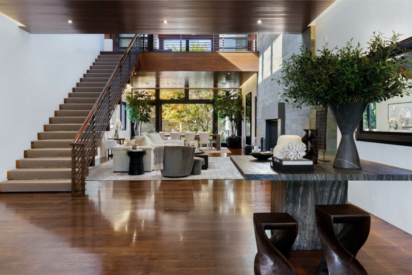 At the heart of the home, there's a voluminous atrium under 35-foot mahogany vaulted ceilings.