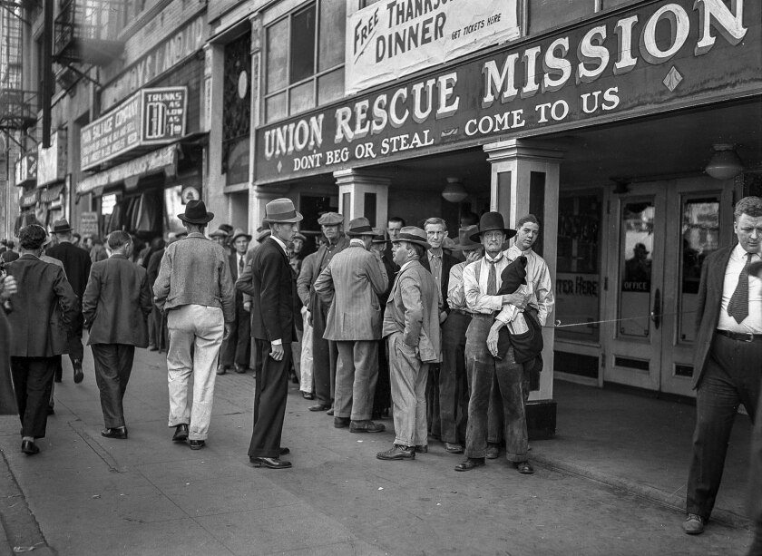 Nov. 26, 1936: Men lined up outside Union Rescue Mission for a Thanksgiving meal.