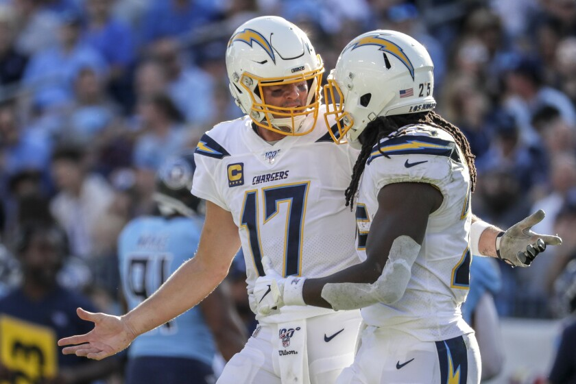 Quarterback Philip Rivers and running back Melvin Gordon discuss a failed play during a loss in Tennessee on Oct. 20, 2019.