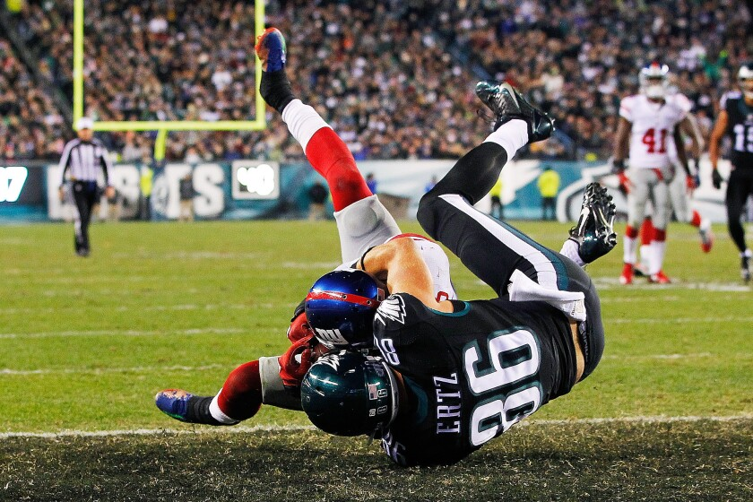 """The New York Giants' Landon Collins snatches the ball away from Zach Ertz of the Philadelphia Eagles during the """"Monday Night Football"""" game in Philadelphia on Oct. 19."""