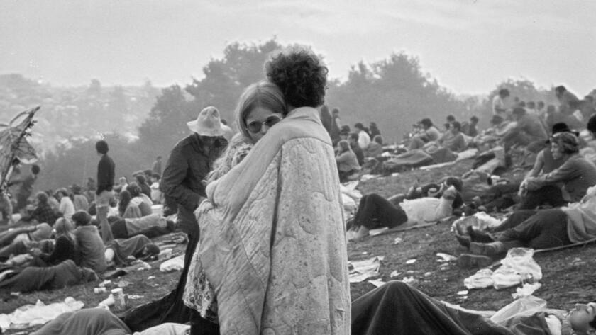 A couple embraces at the Woodstock music festival, August 1969.