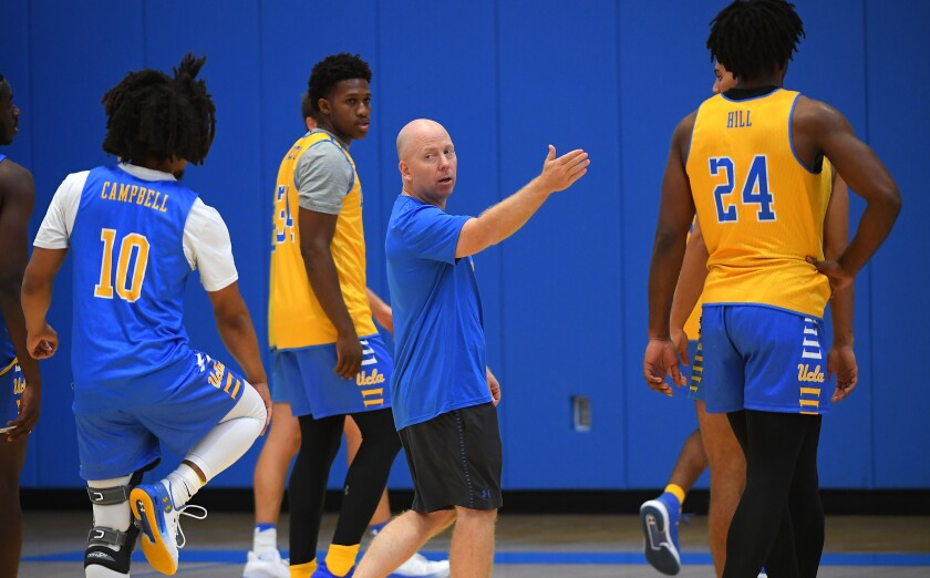 UCLA coach Mick Cronin instructs his players during a practice at the Mo Ostin Basketball Center on Oct. 10.