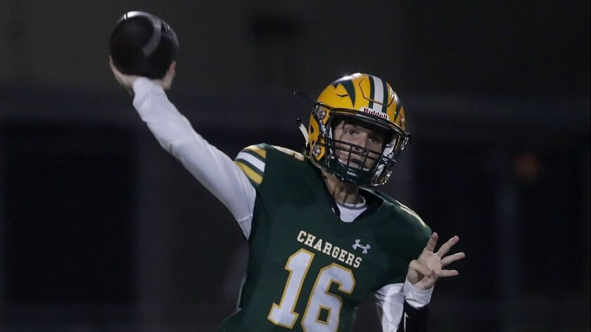 Edison High quarterback Braeden Boyles completes a pass against San Clemente during the first half i
