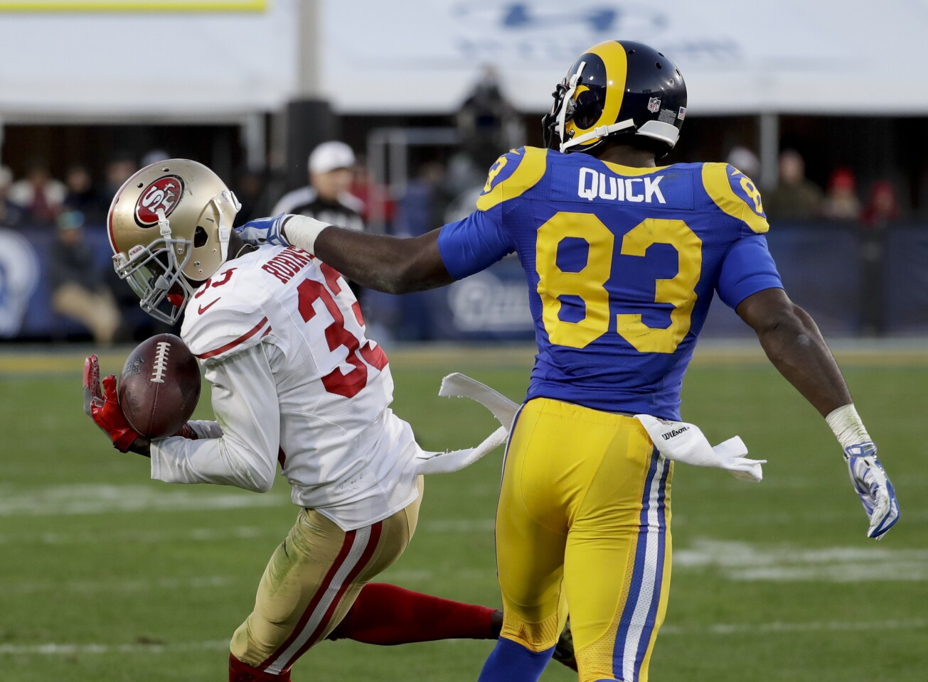San Francisco 49ers cornerback Rashard Robinson, left, intercepts a pass intended for Los Angeles Rams wide receiver Brian Quick during the second half of an NFL football game Saturday, Dec. 24, 2016, in Los Angeles. (AP Photo/Rick Scuteri)