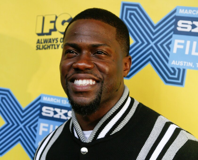 """FILE - In this March 16, 2015 file photo, Kevin Hart arrives for the world premiere of """"Get Hard"""" during the South by Southwest Film Festival in Austin, Texas. Hart is going to go undercover as a Lyft driver in an original series being made by Hart's production company and studio Lionsgate. The show will be made available online through a video on demand service called Laugh Out Loud. (Photo by Jack Plunkett/Invision/AP, File)"""