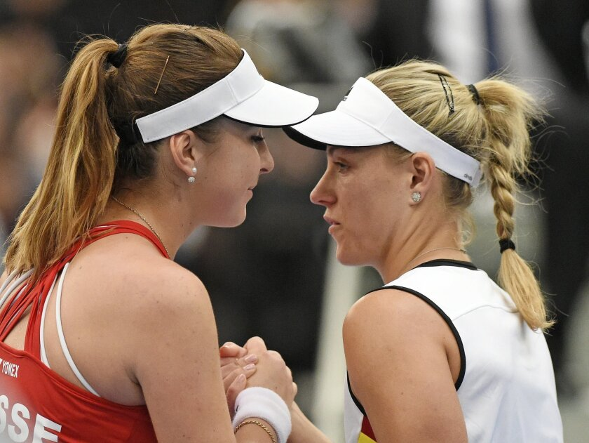 Angelique Kerber of Germany, right,  congratulates Switzerland's  Belinda Bencic  after  their Fed Cup World Group first round tennis match between Germany and Switzerland  in Leipzig, Germany, Sunday, Feb. 7, 2016. (AP Photo/Jens Meyer)