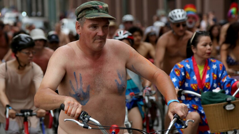 Cyclists -- in various states of dress -- pedal along Third Street in downtown Los Angeles on Saturday.