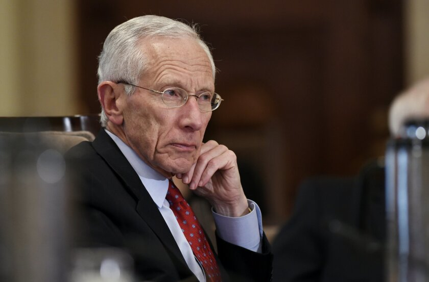 FILE - In this Wednesday, Oct. 22, 2014, file photo, Federal Reserve Vice Chairman Stanley Fischer listens during a meeting of the Board of Governors of the Federal Reserve System at the Federal Reserve in Washington. Fischer said Friday, Aug. 28, 2015, that incoming economic data and market developments will likely determine whether the Fed boosts interest rates in September. (AP Photo/Susan Walsh, File)