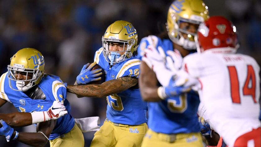 UCLA's Kazmeir Allen follows a block during the second quarter against Fresno State at the Rose Bowl on Saturday.