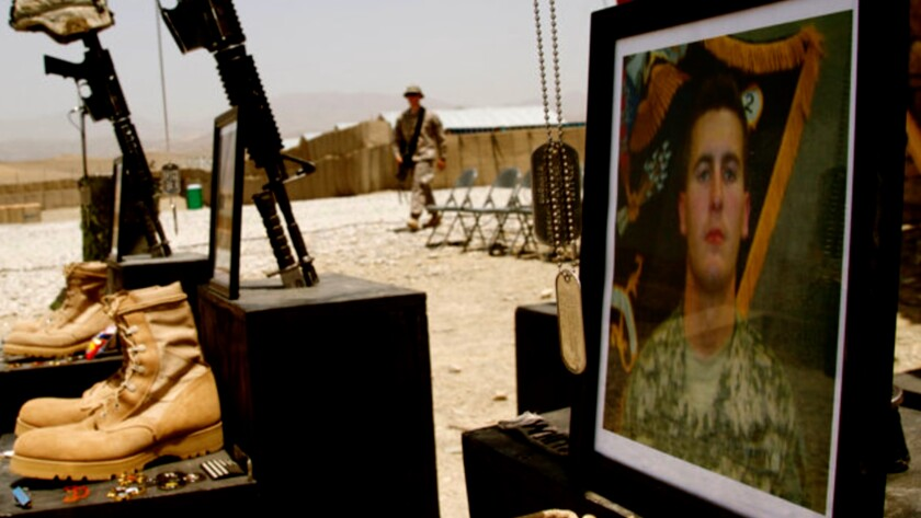 "A scene from a U.S. Army funeral in Afghanistan in the documentary ""No Greater Love."""