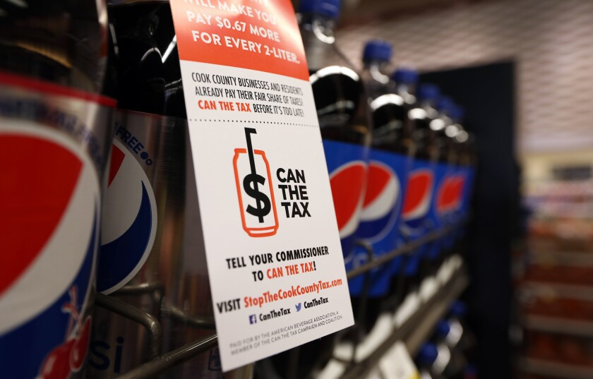An anti-Cook County soda tax placard hangs in the soft drinks aisle at Pete's Fresh Market in Chicago on June 22, 2017.