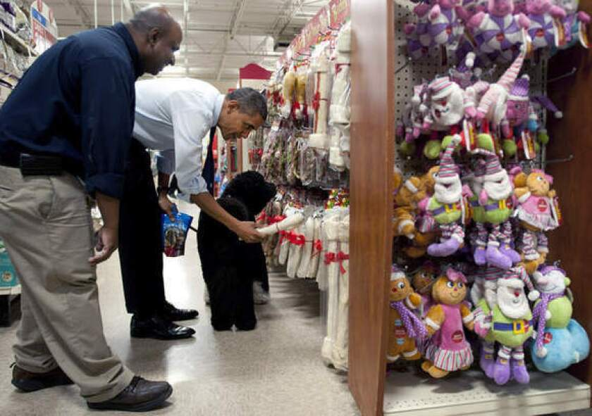President Obama shops for Christmas presents with his dog, Bo, at PetSmart in Alexandria, Va.
