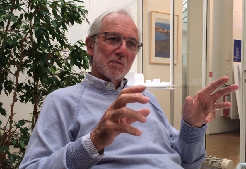 Renzo Piano gestures as he talks in his Paris studio
