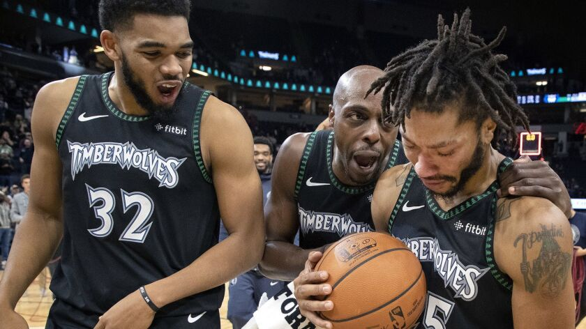 Timberwolves' Derrick Rose, right, is congratulated at the end of the game after he scored a career-high 50 points against the Utah Jazz.
