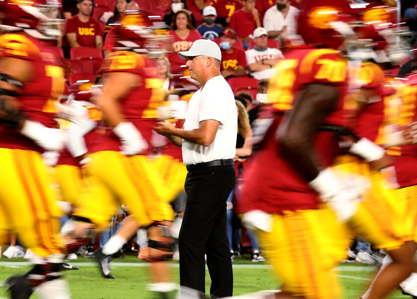 USC coach Clay Helton watches the Trojans warm up before losing to Stanford on Saturday at the Coliseum.