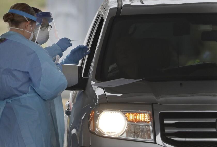 Virus Outbreak Drive-Thru Testing