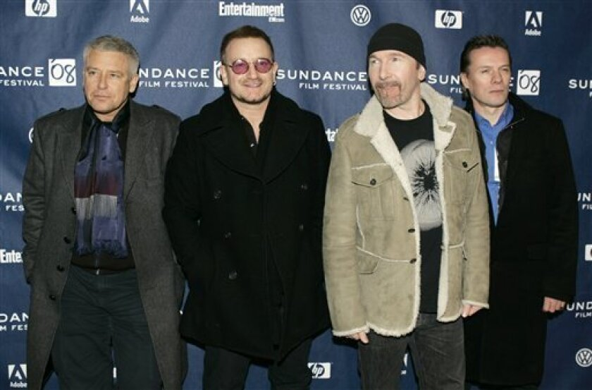 "In this Jan. 19, 2008 file photo, U2 band members, from left, Adam Clayton, Bono, The Edge, and Larry Mullen Jr. arrive at the premiere of their film ""U2 3D"" at the Sundance Film Festival in Park City, Utah. (AP Photo/Amy Sancetta, file)"