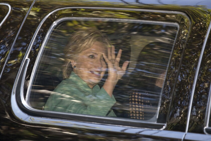 Hillary Clinton arrives at a fundraiser Tuesday hosted by Jessica Biel and Justin Timberlake, who stepped in for Leonardo DiCaprio.