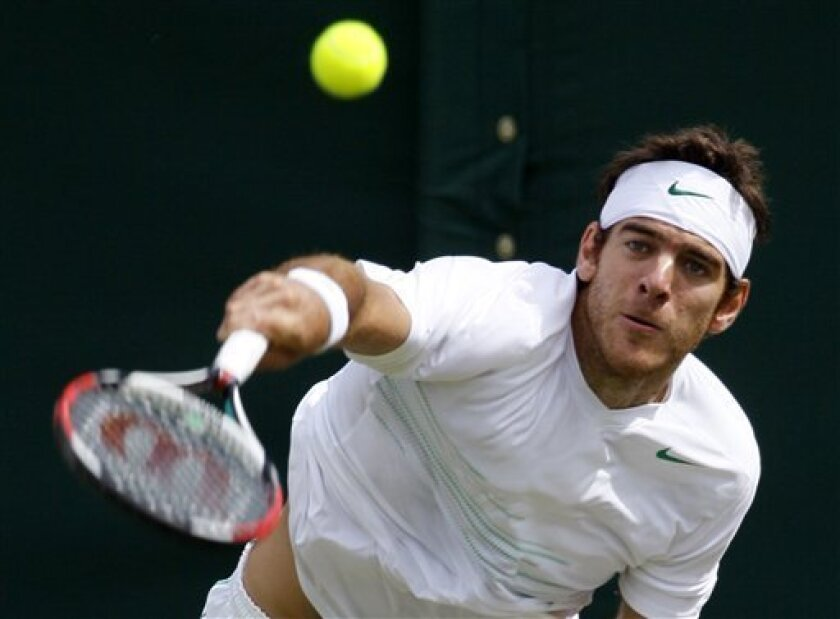 Argentina's Juan Martin Del Potro in action during the match against Belgium's Olivier Rochus at the All England Lawn Tennis Championships at Wimbledon, Thursday, June 23, 2011.(AP Photo/Alastair Grant)