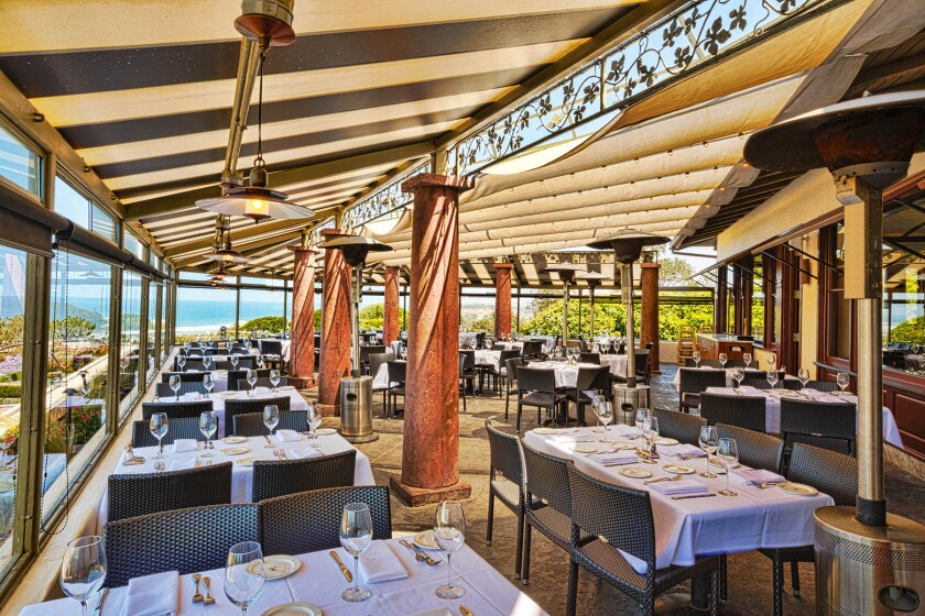 Il Fornaio Del Mar's covered patio is like an elegant outdoor dining room.