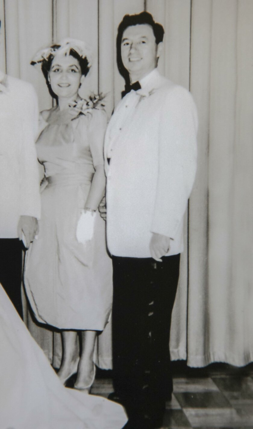 A family photo taken in 1959 in Willmington, Delaware. Helen (left) and Maury (right) at a wedding.