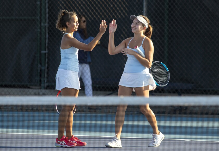 Corona del Mar's Cate Montgomery, left, high-fives Ashley Thomas following a doubles win in the quarterfinals of the CIF Southern Section Division 1 playoffs against Murrieta Valley on Monday in Newport Beach.