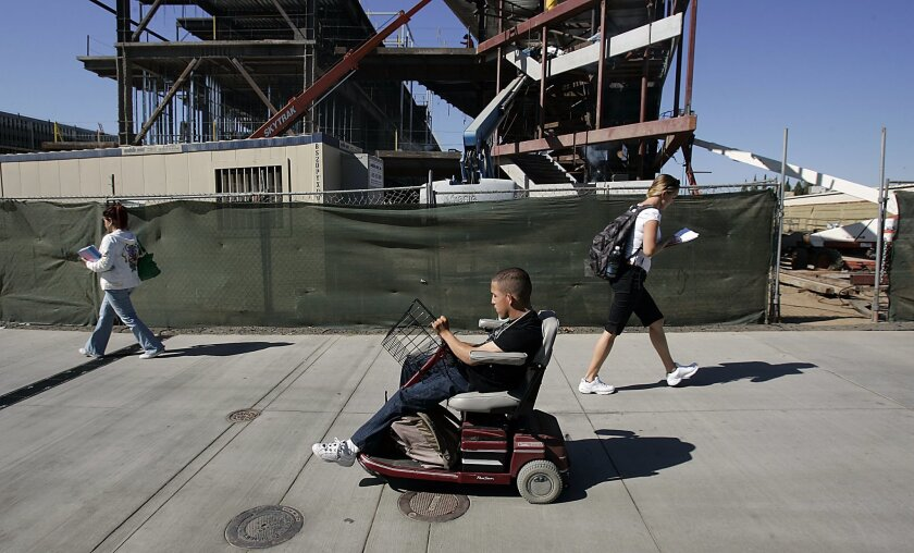 Horus Ocampo has been using a loaner wheelchair to get around Palomar College, but negotiating turns, especially up and down zig-zagging wheelchair ramps, is often impossible.