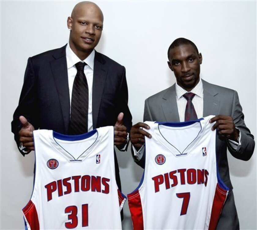 Ben Gordon, right, and Charlie Villanueva hold their new Detroit Pistons jerseys, Wednesday, July 8, 2009, in Auburn Hills, Mich. Their signing signaled the start of a new era for a new-look franchise. Gordon, one of the top free agents this summer, signed a $55 million, five-year contract in leaving the Chicago Bulls and Villanueva a $35-million, five-year deal as he bid farewell to the Milwaukee Bucks. (AP Photo/Carlos Osorio)