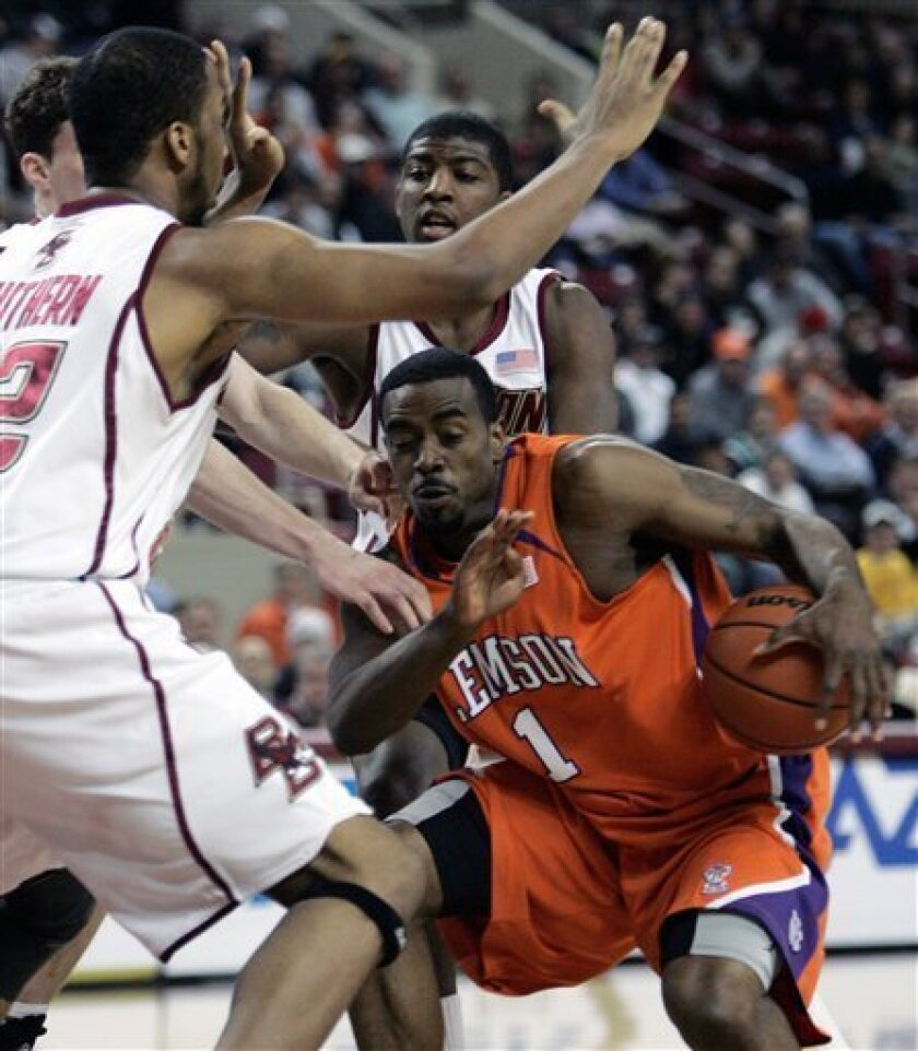Boston College's Josh Southern, left, blocks Clemson's K.C. Rivers (1) in the first half of an NCAA college basketball game, Tuesday, Feb 10, 2009, in Boston. (AP Photo/Michael Dwyer)