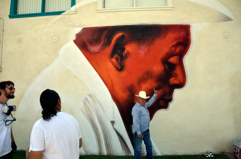 A new mural by L.A. artist El Mac in downtown Coachella depicts a farm worker.