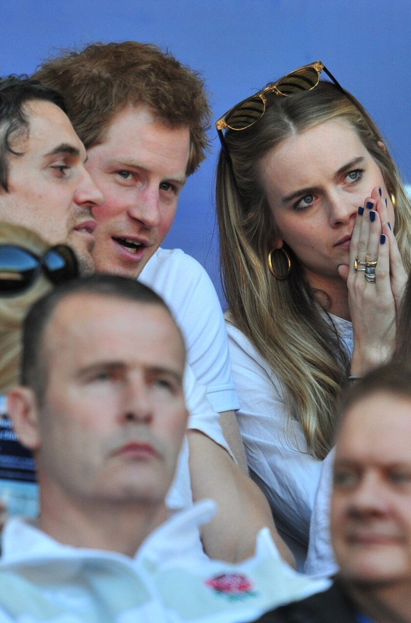Prince Harry and British socialite Cressida Bonas watch the England-Wales match during the Six Nations International Rugby Union.