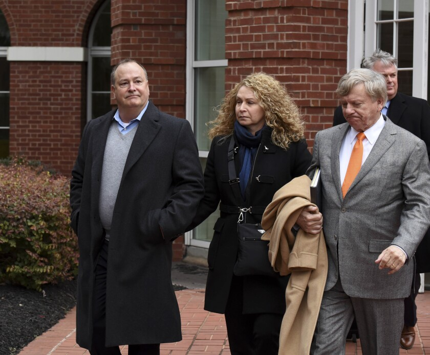 """FILE - In this Feb. 9, 2016, file photo, former Pilot Flying J president Mark Hazelwood, left, leaves federal court after being arraigned in Knoxville, Tenn. Federal prosecutors are not pursuing a new trial against the former president of Pilot Flying J and two of his former employees after their 2018 convictions in a cheating scheme were overturned. A motion made in U.S. District Court in Knoxville asks a judge to sign off on a request to drop the remaining charges against Hazelwood, former Vice President Scott """"Scooter"""" Wombold and former account representative Heather Jones. (Michael Patrick /Knoxville News Sentinel via AP, File)"""
