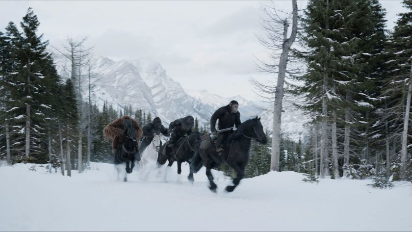 """Karin Konoval as Maurice, Michael Adamthwaite as Luca, Terry Notary as Rocket and Andy Serkis as Caesar in the film """"War for the Planet of the Apes."""""""