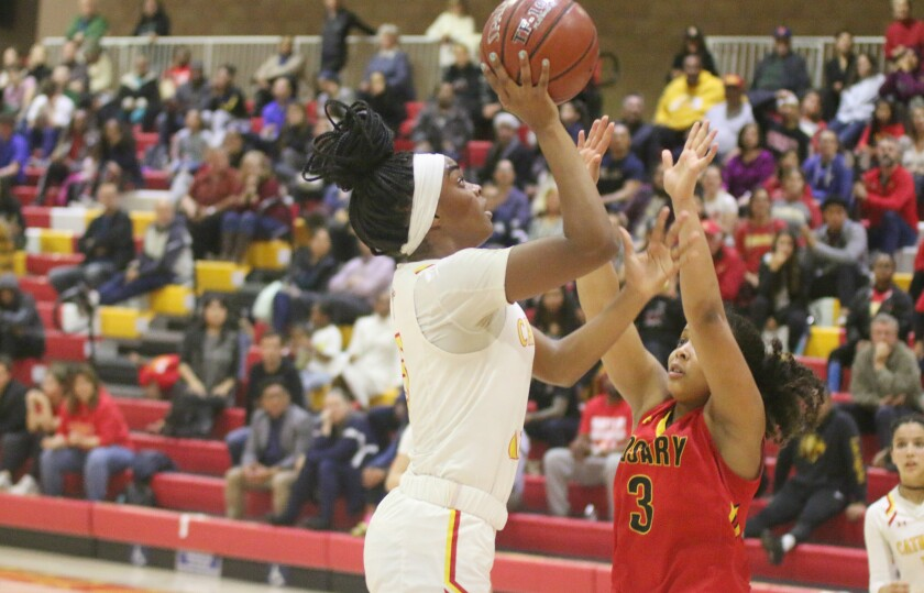 Cathedral Catholic's Taryn Johnson goes in for two of her team high 13 points.