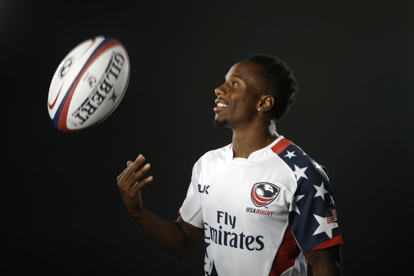 In this March 7, 2016 photo, rugby player Carlin Isles poses for photos at the 2016 Team USA Media Summit, in Beverly Hills, Calif. The 26-year-old is a good bet to earn a spot on Team USA as rugby sevens makes its Olympic debut at the Rio Games. Maybe even in track as well, should he qualify in the 100 meters at the Olympic trials in July.(AP Photo/Jae C. Hong)