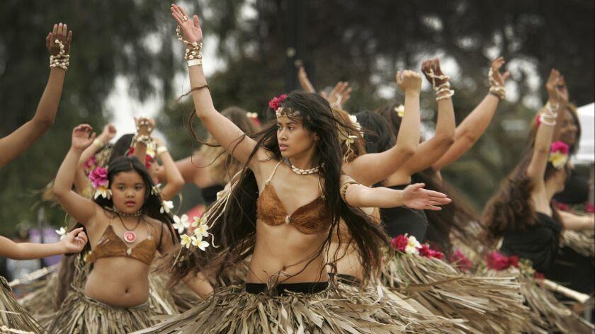Members of Imahen Taotao Tano, perform dances of Guamanian heritage during the annual Pacific Islander Festival at Ski Beach.