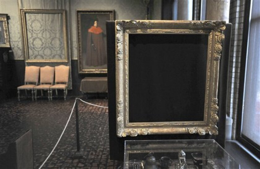 """FILE - In this Thursday, March 11, 2010 file photo, empty frames from which thieves took """"Storm on the Sea of Galilee,"""" left background, by Rembrandt and """"The Concert,"""" right foreground, by Vermeer, remain on display at the Isabella Stewart Gardner Museum in Boston. The paintings were among more th"""