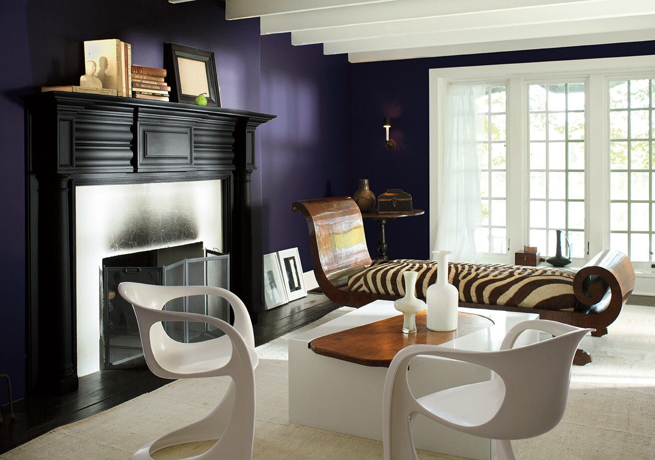 Benjamin Moore's color of the year is Shadow (chip no. 2117-30), a dark purple shade of black amethyst that corresponds to a rich palette of similarly saturated colors.